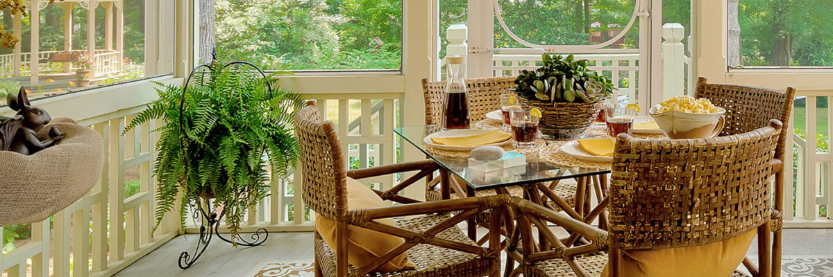 Sunroom set up with iced tea and snacks for guests