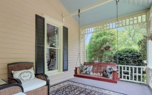 An inviting porch swing awaits you.