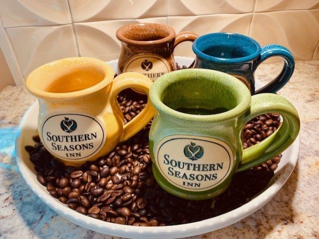 Images showing colorful Southern Seasons Inn custom mugs